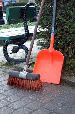 spade and broom