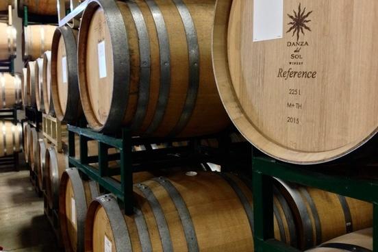 stacked oak barrels of wine