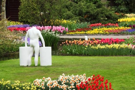 statue in flower garden