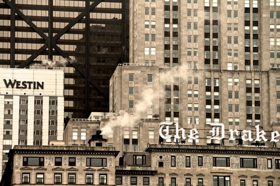 steam rising up from buildings