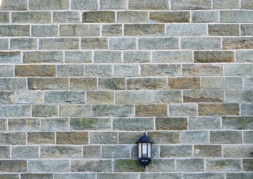 stone wall and the lamp