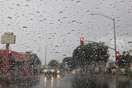 street lights through rain drops on windshield