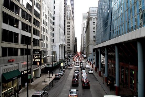 street traffic in between city buildings