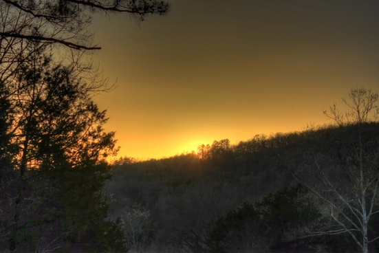 sun behind the trees at meramec state park missouri