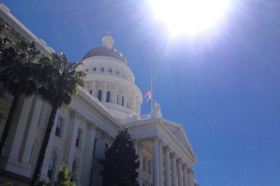 sun over state capital government building