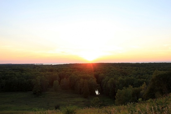 sun setting over forest at potawatomi state park wisconsin