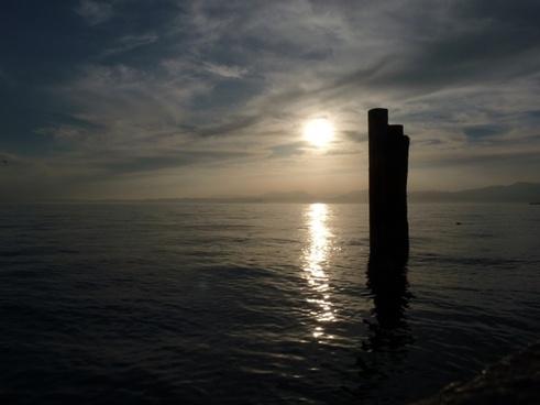 sun setting sun water