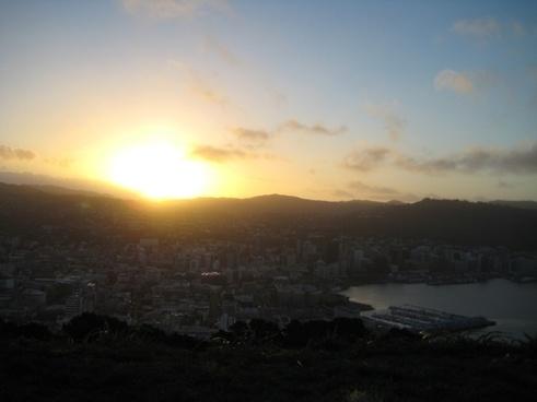 sun shining on city harbor