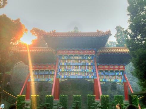 sun shining on pavillion in beijing china