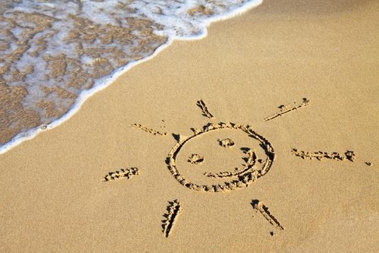 sun sign in sand