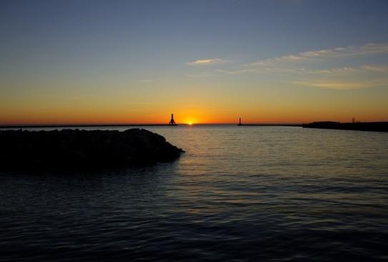 sunrise between the lighthouses at port washington wisconsin