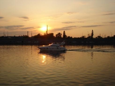 sunset boat ocean