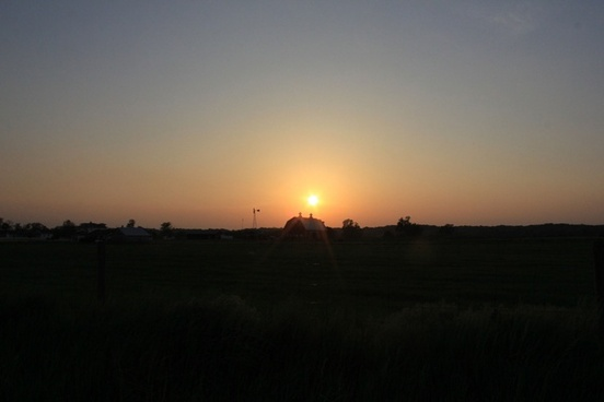 sunset over farm at prophetstown state park indiana