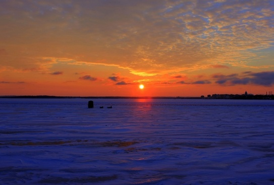 sunset over icy lake in madison wisconsin