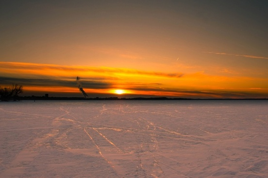 sunset over the ice on lake mendota in madison wisconsin