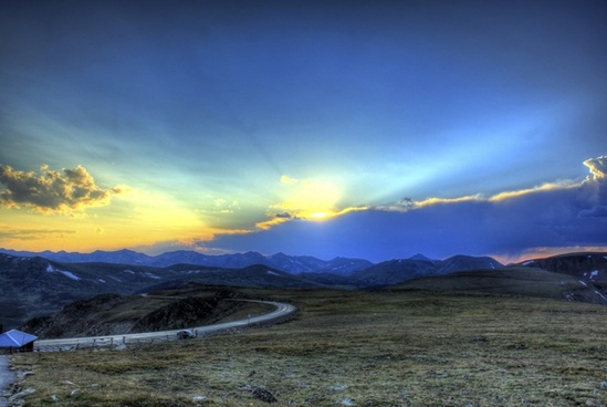 sunset over the mountains at rocky mountains national park colorado
