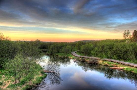 sunset over the river boardwalk in the upper peninsula michigan