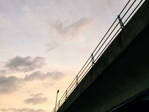 sunset over train station