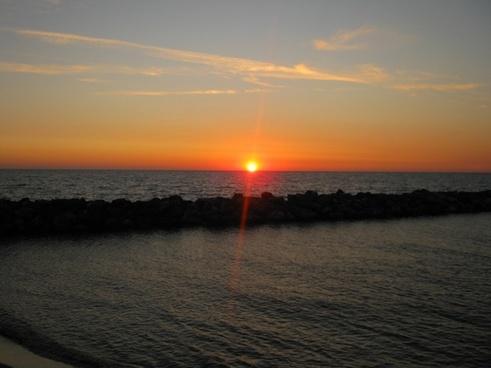 sunset pisa sea