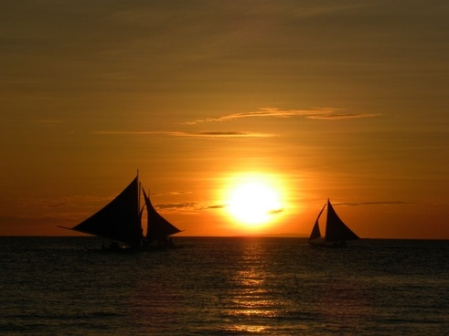 sunset sailing boats