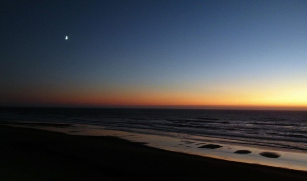 sunset shoreline coast