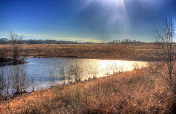 sunshine over the lake at weldon springs state natural area missouri