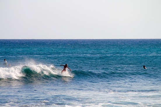 surfer boy riding wave