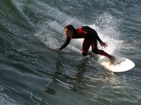 surfer surfing huntington
