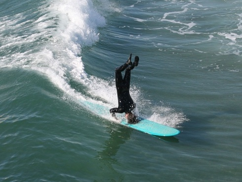 surfer surfing huntington