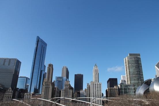 tall buildings of city skyline against clear sky