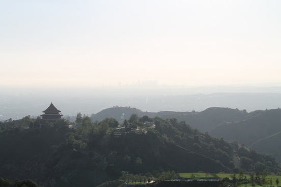 temple on hills with city in background