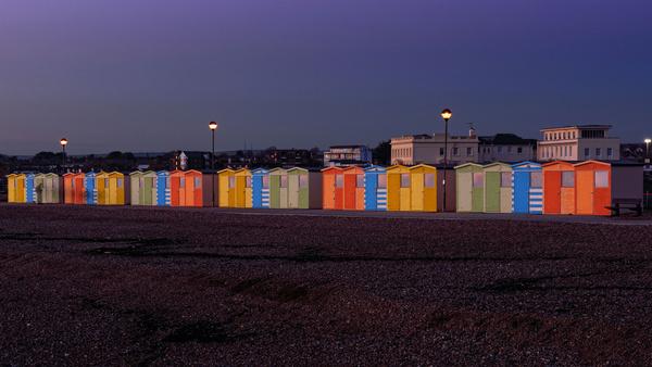 the beach huts seaford at dusk