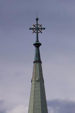 the church tower cross lightning rod