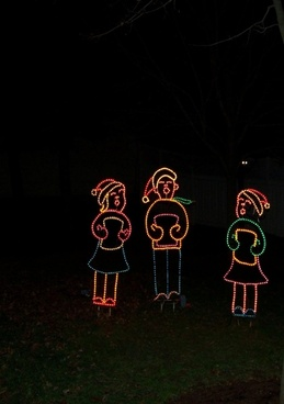 three carolers christmas lights