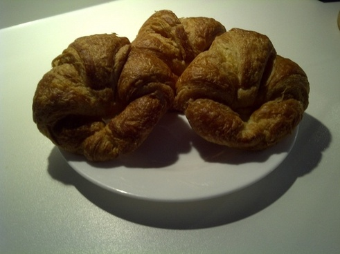 three croissants on a white plate