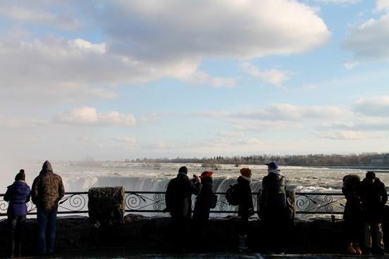tourists watching niagara falls