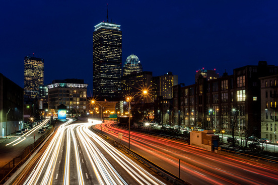 traffic streaming through downtown boston just after sunset