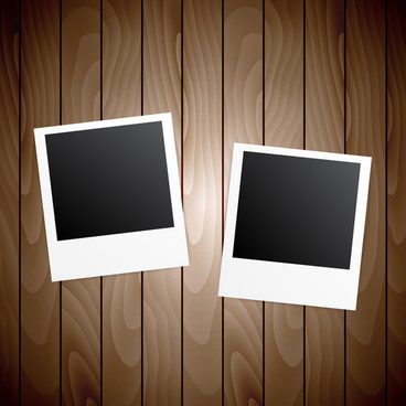 two blanks photo frames on wooden