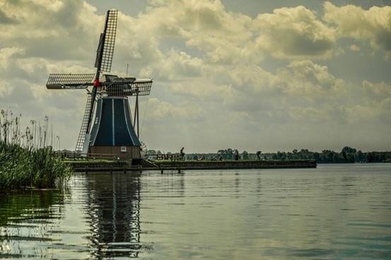 typical dutch windmill at a lake