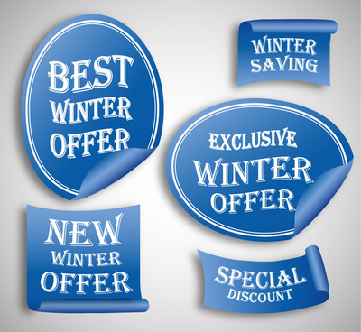 various shapes winter sales labels on blue background