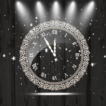 vintage clock decoration on wooden background and lights