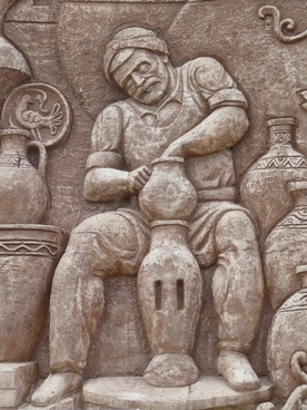 wall relief pottery man