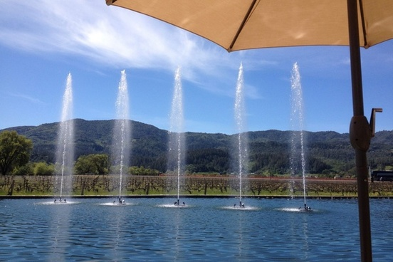 water fountains in front of mountains