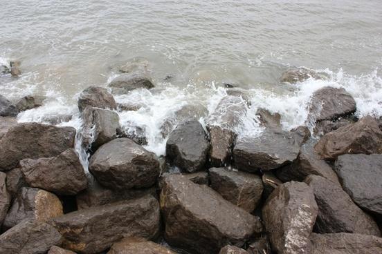 waves crashing on to rocks