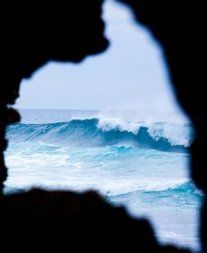 waves through rock window