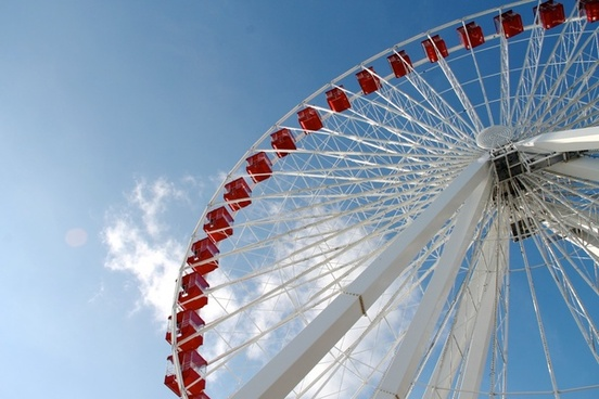white 038 red ferris wheel in blue sky with white clouds