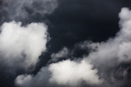 white clouds on dark sky