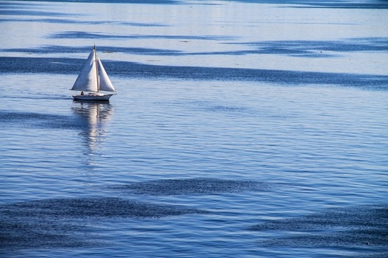 white sailboat on blue ocean