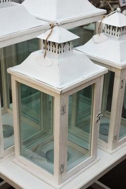 white wooden lantern