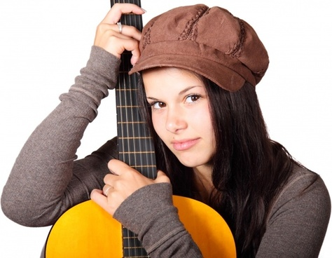 woman holding guitar
